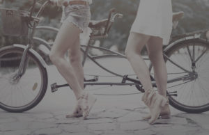 two girls with tandem bike