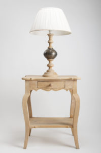 nightstand with wooden lamp