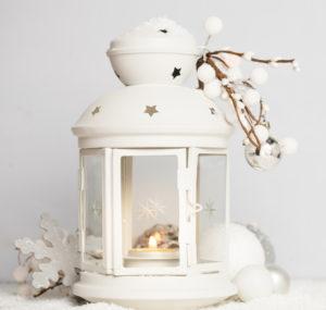 white lantern with winter decor
