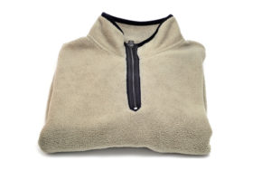 a polar fleece sweater isolated on a white background