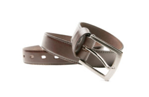 Brown leather belt with a white background.