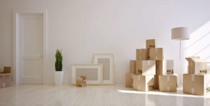 stack of boxes in living room ready to be moved