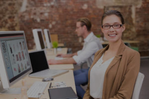 woman smiling at computer in office
